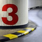 Street road with curve turn, parking garage number three — Stock Photo