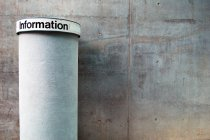 Advertising pillar at wall, information — Stock Photo