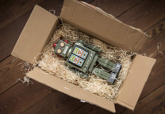Retro robot in cardboard box — Stock Photo