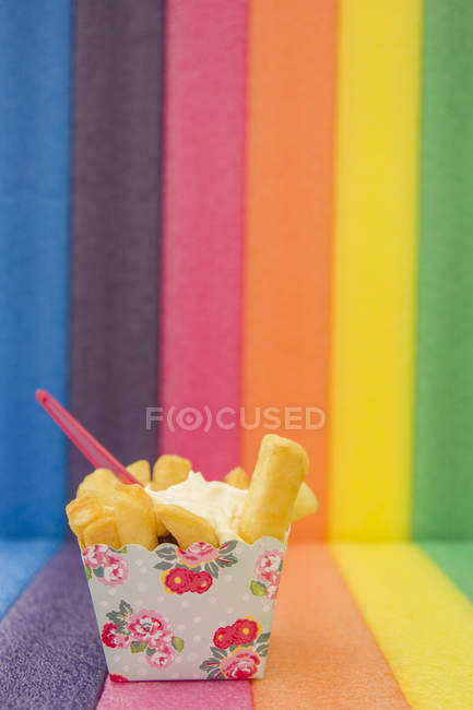 French fries in beautiful floral take away box and fork — Stock Photo