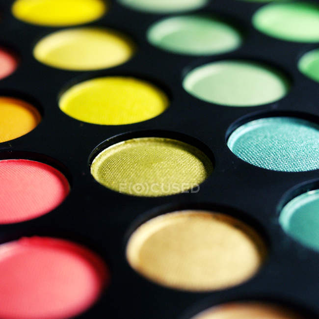 Colorful cosmetics makeup eye shadows — Stock Photo