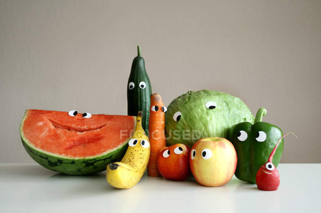 Different fruits and vegetables with cartoon eyes — Stock Photo