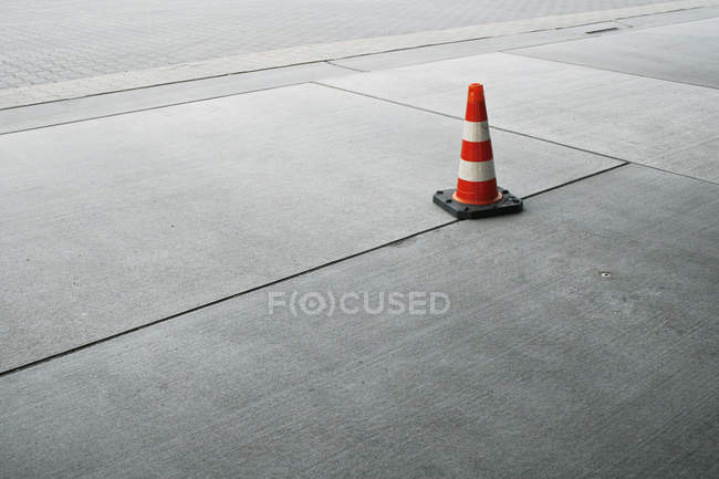 Asphalt road with traffic cone — Stockfoto