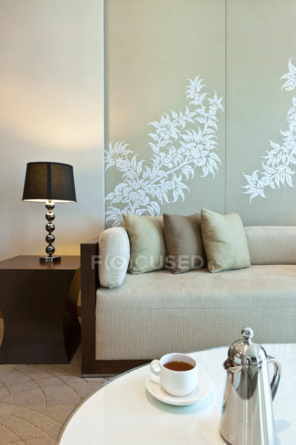Sofa in living room with table and lamp — Stock Photo