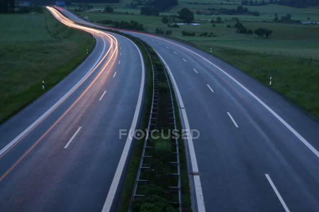 Transport and traffic, highway road with double lanes, blurred motions — Stock Photo