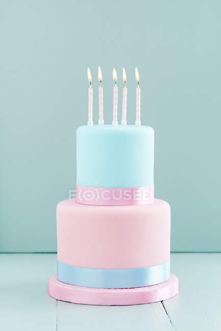 Fondant cake with burning candles, Two Tier Cake — Stock Photo