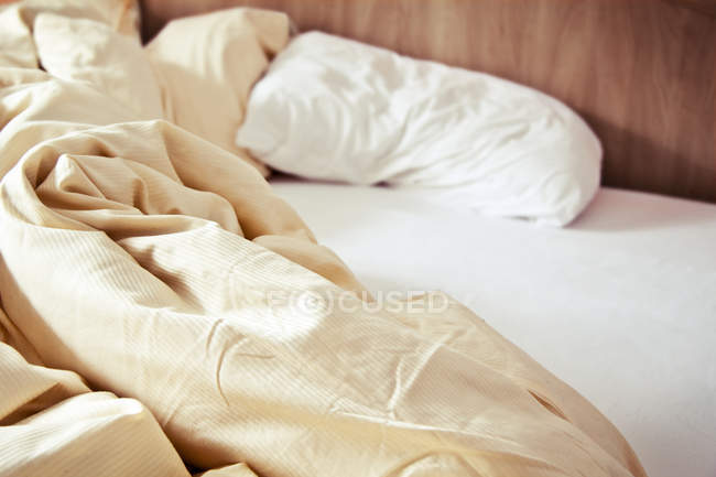 Comfortable cozy bed with pillow and blanket — Stockfoto