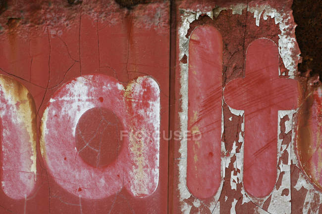 Typescript on old aged metal wall — Stock Photo