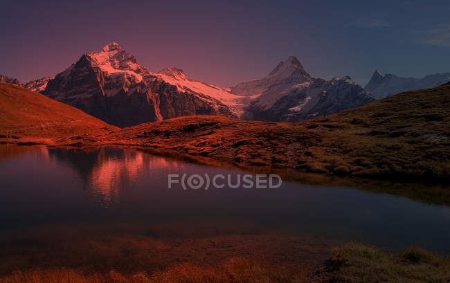 Sunset and lake in mountains,  Swiss Alps — Stock Photo