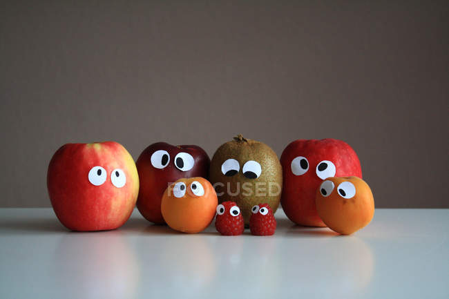 Different fruits with funny cartoon eyes — Stock Photo