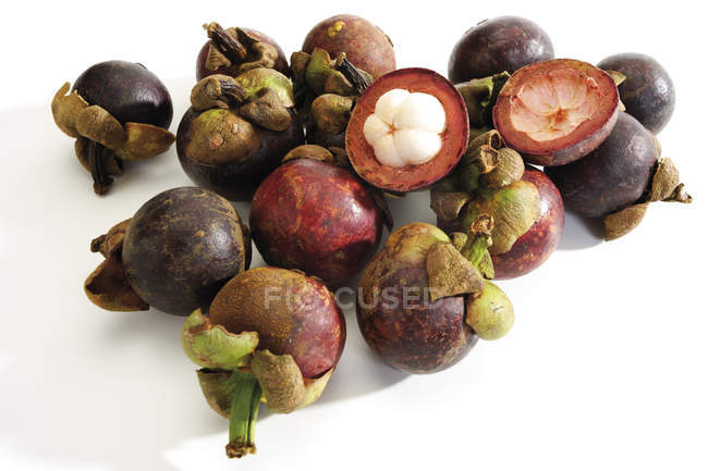Purple mangosteen fruits isolated on white — Stock Photo