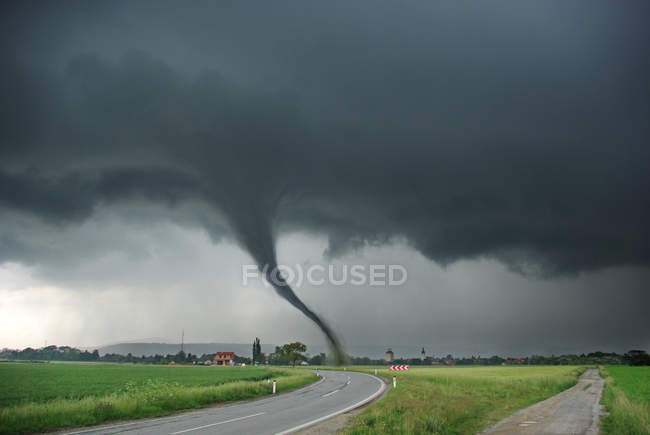 Dangerous tornado in countryside field — Stock Photo