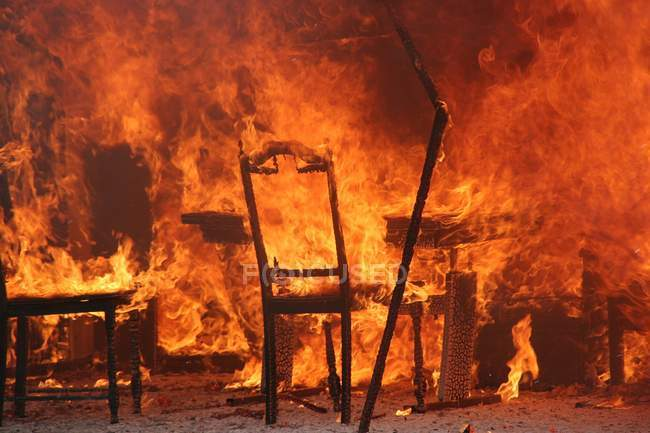Full frame burning chairs in fire — Stock Photo