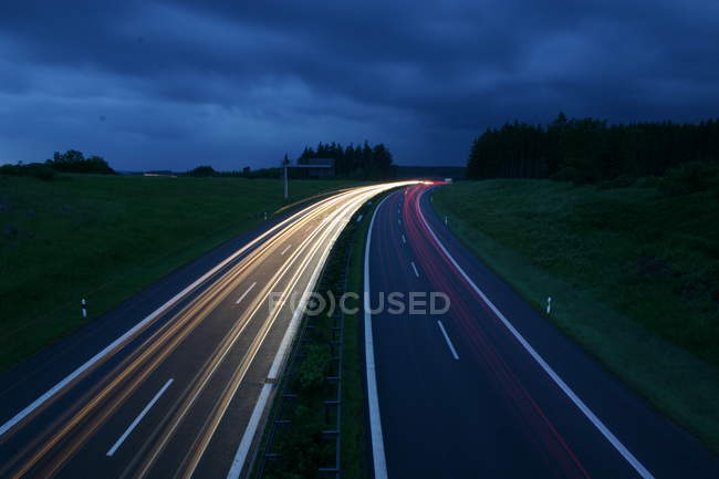 Highway roads at night in blurred motions — Stock Photo