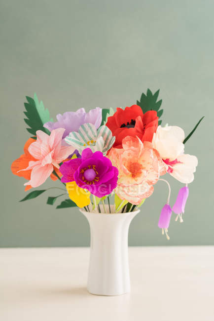 Creative colorful paper flowers bouquet in vase — Stock Photo