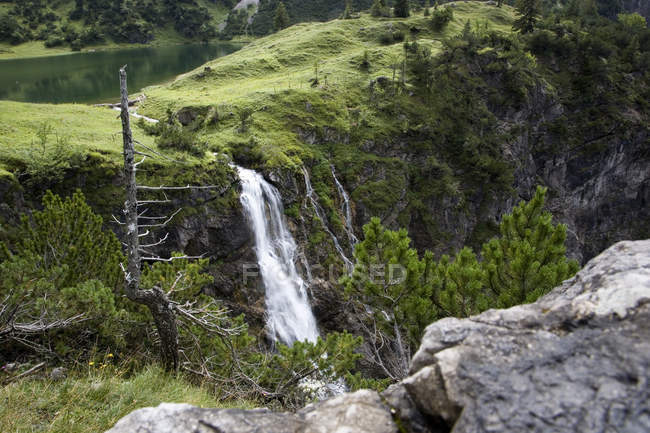Waterfall flow from green hill — Stock Photo