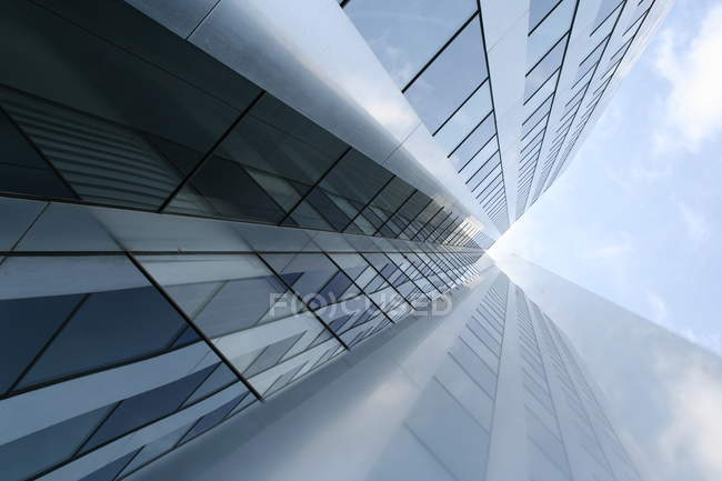 Futuristic building with glass facade, low angle shot — Stock Photo