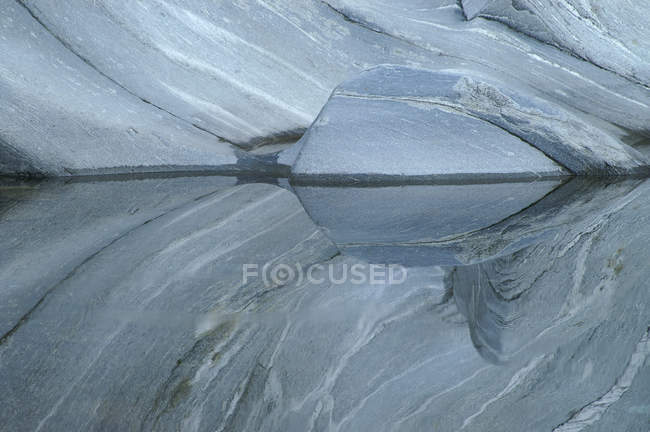 Grey granite stone, reflection of rock — Stock Photo
