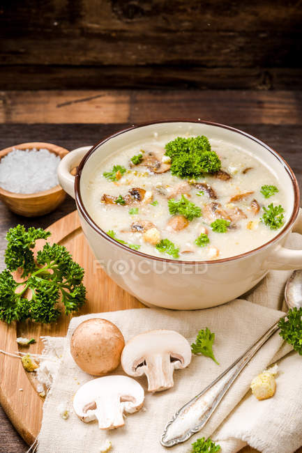 Mushroom soup in pan with herbs and fresh champignons — Stock Photo