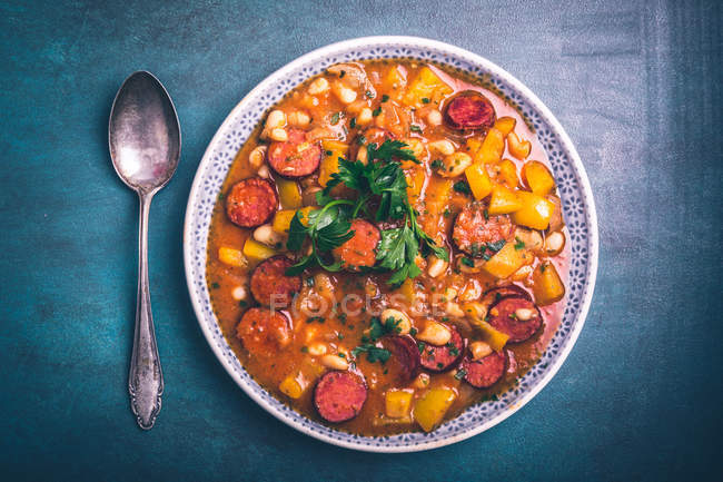 Bowl of stew with sliced cabanossi sausage — Stock Photo