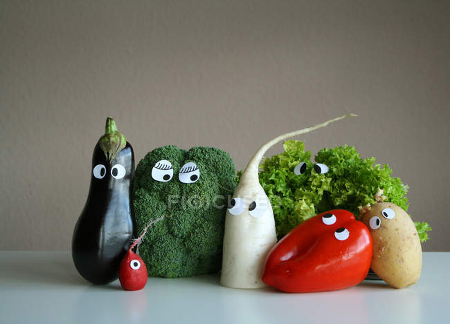 Different vegetables with cartoon eyes — Stock Photo