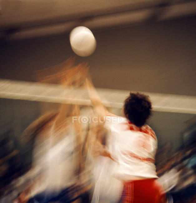 Blurred motion shot of volleyball players — Stock Photo