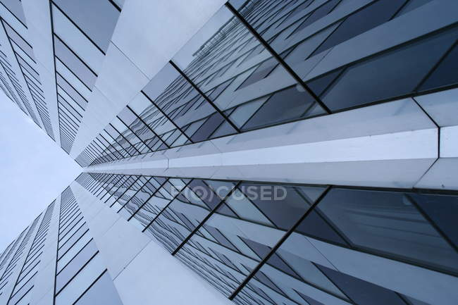 Office building with glass facade, low angle shot — стокове фото