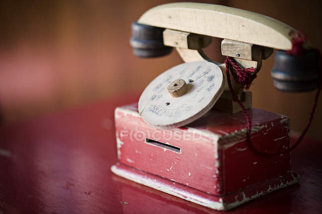 Old fashioned telephone wooden toy — Stock Photo