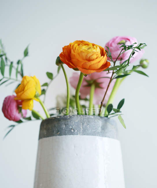 Grey vase with flowers bouquet — Stock Photo