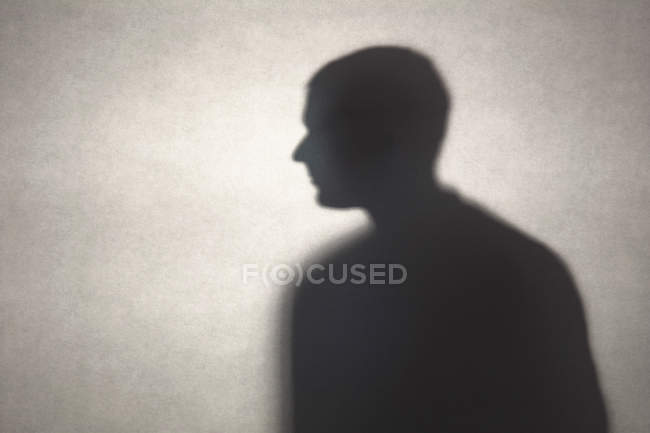 Solitude man silhouette shadow on wall — Stock Photo