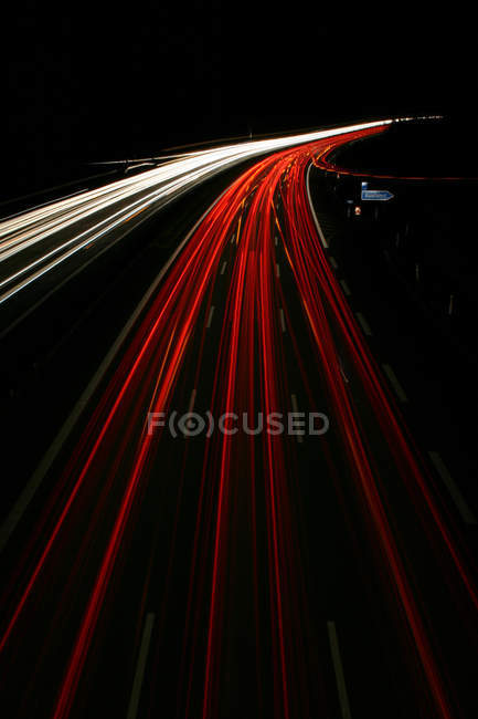 Highway road with double lanes, motion and speed cars lighting, blurred motions — Stock Photo