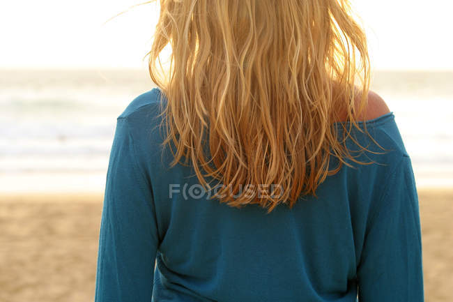 Blonde hair woman on beach relaxing, partial view — Stock Photo