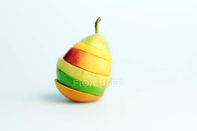 Mixture of different fruits slices in pear — Stock Photo