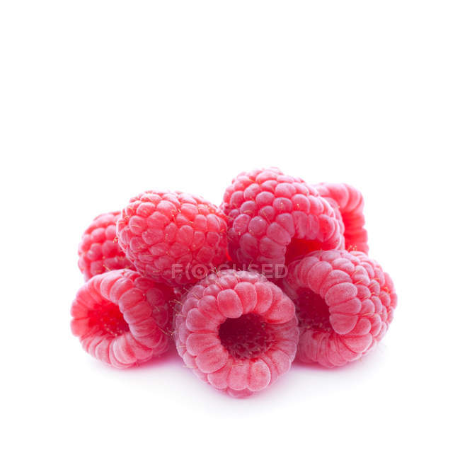 Heap of fresh raspberries isolated on white — Stock Photo