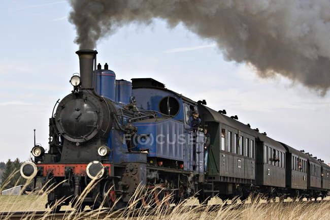 Retro train locomotive with smoke cloud — Stock Photo