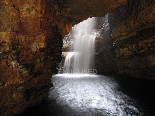 Waterfall and river in smoo cave, Durness in Sutherland, Highland, Scotland — Stock Photo