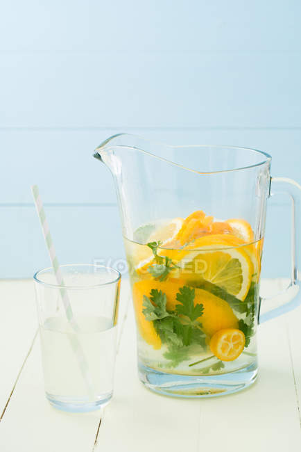 Cold drink, orange slices with mint leaves in jug — Stock Photo