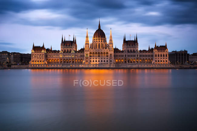 Houses of parliament in Budapest, long exposure of river water — Stock Photo