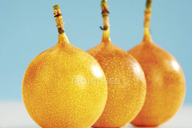 Three whole yellow passion fruits — Stock Photo