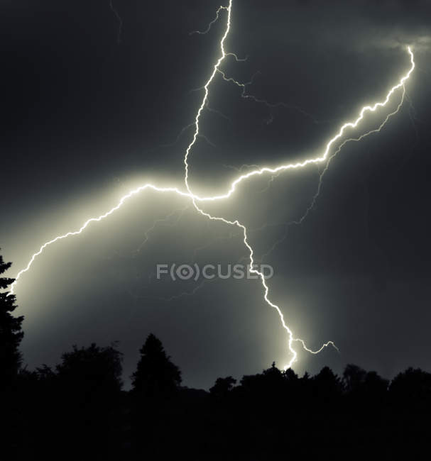 Rainy dark sky with lightning strikes — Stock Photo
