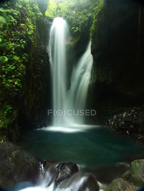 Gitgit Waterfall flow from mountains,l Bali, Indonesia — Stock Photo