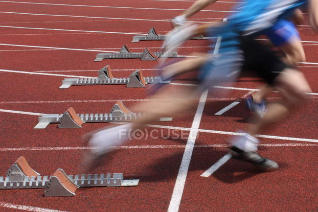 Blurred image of running people on start, marathon competition — Stock Photo