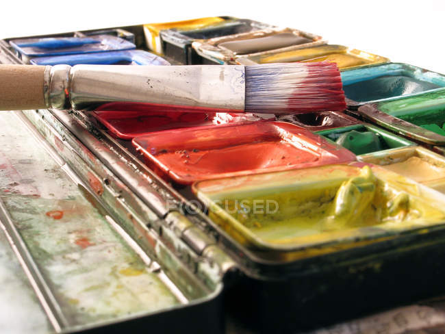 Colorful watercolor paint and brush — Stock Photo