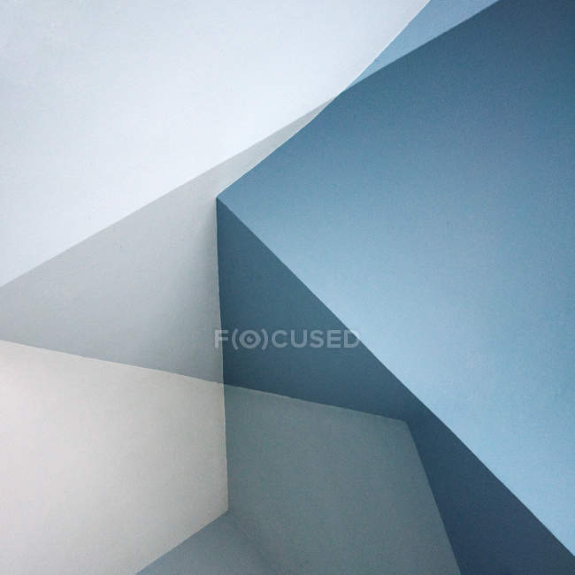 Corners of room wall, blue light geometrical shapes — Stock Photo