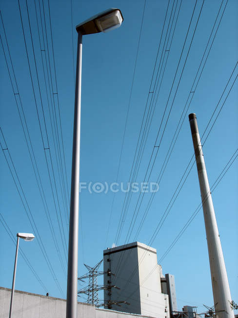 Smoke stack of power station and power lines — Stock Photo