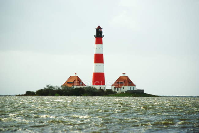 Lighthouse on island in sea water, Lighthouse in Westerhever — Stock Photo