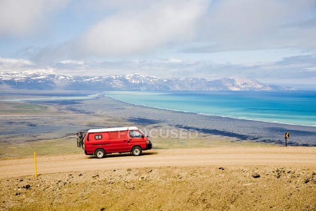 Red camping mini bus driving in Iceland — Stock Photo