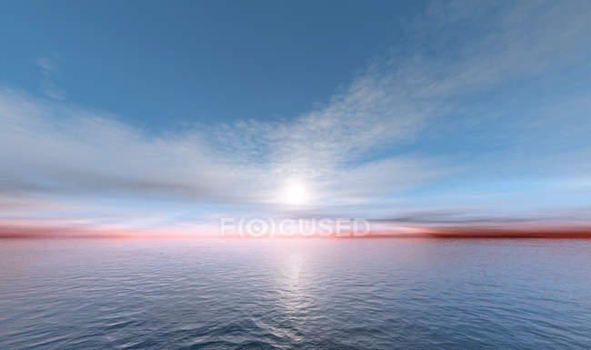Sunset in sky above calms sea water — Stock Photo