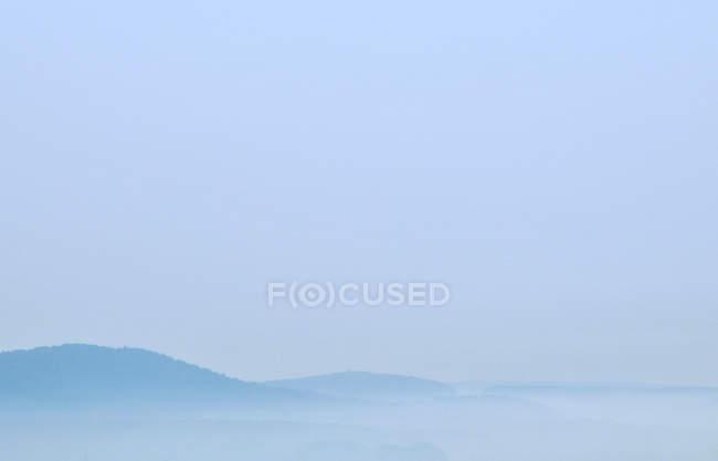 Foggy blue mountains view — Stock Photo
