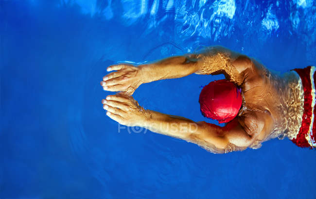 Water sport, swimmer person in pool hat swimming in pool — Stock Photo